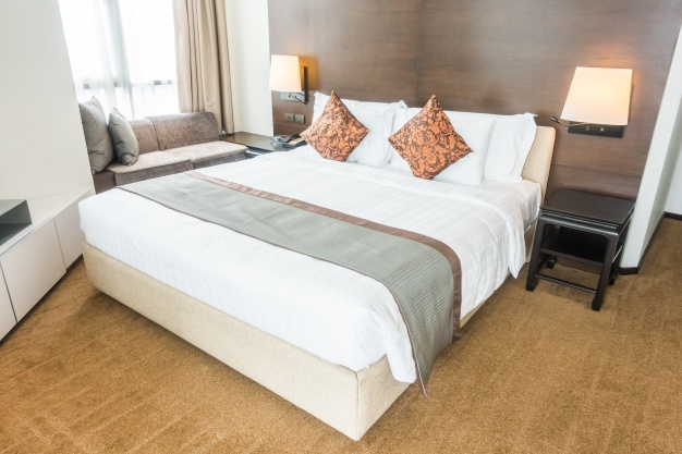 double-bed-with-pillows_1203-21
